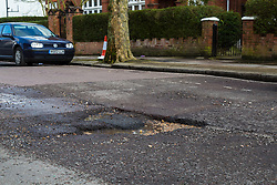 A deep pothole on Brondesbury Road in leafy Queens Park in west London as the recent cold, wet weather has given rise to the increase in potholes and road surface deterioration in the capital. London, March 28 2018.