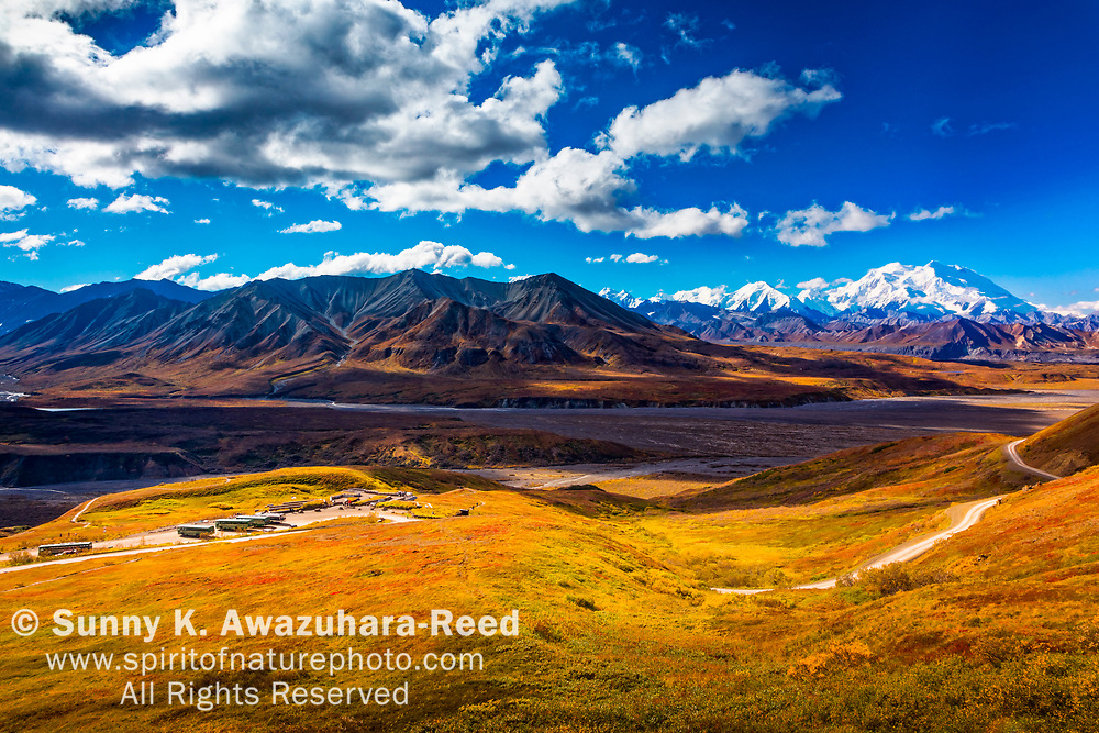 View of Mount Denali (McKinley), Mt. Eielson, and Eielson Visitor Center. Fall color tundra hill is in the foreground. Denali National Park & Preserve, Alaska, Autumn.