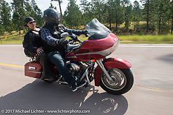 Milwaukee Mike Johnston and Jacole Galperin on the Aidan's Ride to raise money for the Aiden Jack Seeger nonprofit foundation to help raise awareness and find a cure for ALD (Adrenoleukodystrophy) during the annual Sturgis Black Hills Motorcycle Rally. Vanocker Canyon between Sturgis and Nemo, SD, USA. Tuesday August 8, 2017. Photography ©2017 Michael Lichter.