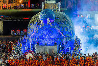"Floats in in the Carnaval parade of Estacio de Sa samba school in the Sambadrome, Rio de Janeiro, Brazil.           <br /> <br /> The theme  of their parade is ""Stones"" which includes a 2001:A Space Odyssey type scene with cavemen watching a rock open into a spacecraft with astronauts coming out."