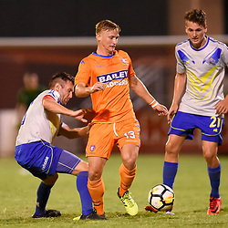 BRISBANE, AUSTRALIA - JANUARY 27: Shaun Carlos of Lions controls the ball under pressure from Michael Angus of the Strikers during the Kappa Silver Boot Grand Final match between Lions FC and Brisbane Strikers on January 27, 2018 in Brisbane, Australia. (Photo by Patrick Kearney)