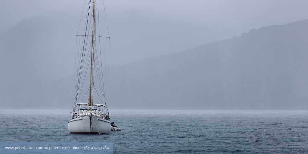 Yacht Takaroa at anchor in Tryphena Harbour during three days of severe storm.