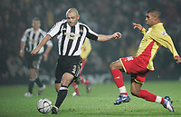 Photo: Marc Atkins.<br /> Watford v Newcastle United. Carling Cup. 07/11/2006.<br /> Stephen Carr (L) of Newcastle in action with Hameur Bouazza of Watford.