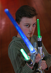 © Licensed to London News Pictures. 04/11/2015. London, UK. A boy plays with Blade Builders Jedi Master Light Sabre at the Dream Toys Christmas event. Photo credit: Peter Macdiarmid/LNP
