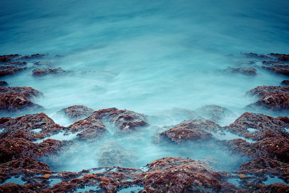 Long exposure of waves and lave stones - manipulated photograph