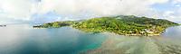 Panoramic aerial view of coastline & ocean front homes, Pufau, Tevaitoa, Raiatea, Leeward Islands, French Polynesia