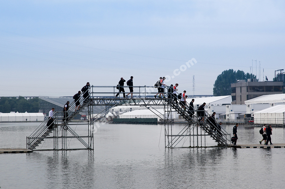 Force India and Virgin Racing team members crossing the brigde towards the paddock before the 2010 Canadian Grand Prix in Montreal. Photo: Grand Prix