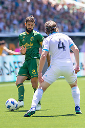 May 13, 2018 - Portland, OR, U.S. - PORTLAND, OR - MAY 13: Portland Timbers midfielder Diego Valeri looks for a pass guarded by Seattle Sounders midfielder Gustav Svensson during the Portland Timbers 1-0 victory over the Seattle Sounders on May 13, 2018, at Providence Park in Portland, OR. (Photo by Diego Diaz/Icon Sportswire) (Credit Image: © Diego Diaz/Icon SMI via ZUMA Press)