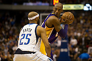 Kobe Bryant (24) of the Los Angeles Lakers stares at Vince Carter (25) of the Dallas Mavericks at the American Airlines Center in Dallas on Sunday, February 24, 2013. (Cooper Neill/The Dallas Morning News)