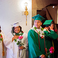 051613       Cable Hoover<br /> <br /> Gallup Catholic High School graduates Xander Parker, right, Starr Salcido and others line up for their graduation ceremony at El Morro Theater Thursday.