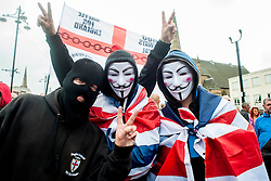 "Rotherham England<br /> 13 September 2014 <br /> Protestors wearing Anonymous masks and Union Flags with EDL supporters outside Rotherham Town Hall before the start of the English Defence Leagues Justice for the Rotherham 1400 March on Saturday Afternoon described by an EDL Facebook Page as ""a protest against the Pakistani Muslim grooming gangs"" on Saturday Afternoon <br /> <br /> <br /> Image © Paul David Drabble <br /> www.pauldaviddrabble.co.uk"