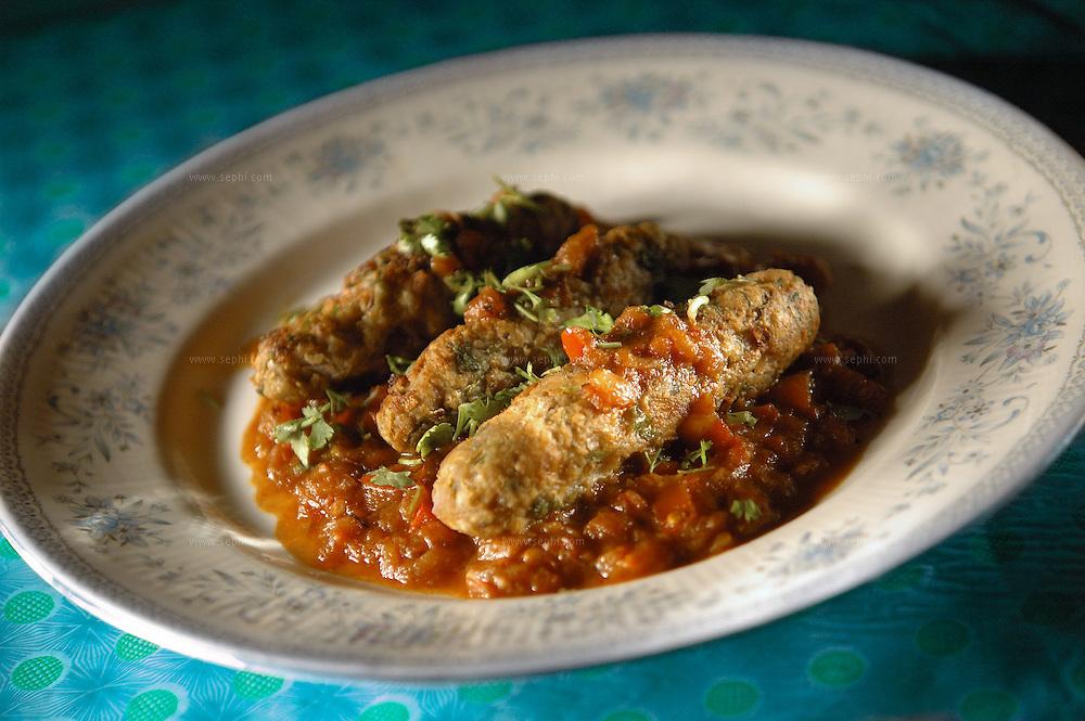 Besan Ki Kandli - gram flower kebab in red sauce ( Recipe available upon request )