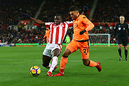 Kurt Zouma of Stoke City tackles Alex Oxlade-Chamberlain of Liverpool. Premier league match, Stoke City v Liverpool at the Bet365 Stadium in Stoke on Trent, Staffs on Wednesday 29th November 2017.<br /> pic by Chris Stading, Andrew Orchard sports photography.