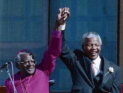 June 10, 1994 - Cape Town, ZAF - Nelson Mandela, right, holds hands with Bishop Desmond Tutu in Cape Town, South Africa, in a 1994 file image. Mandela died on Thursday, Dec. 5, 2013. (Credit Image: © Jerry Holt/TNS/ZUMAPRESS.com)