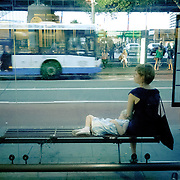 A woman waiting the bus in Sydney Bus terminal near the ferry wharf in the CBD, with her child, at the end of Australia Day.