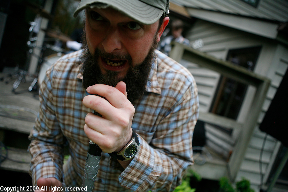 """Patrick Hawkins of TremFu (Tremendous Fucking) performs during an outside music show at a house during the Spirit of '68 sponsored Cookout and music performances at """"the Compound"""" in Ellettsville near Bloomington, Indiana. May 2, 2008."""