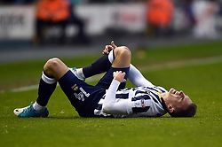 Jed Wallace of Millwall clutches his leg - Mandatory by-line: Patrick Khachfe/JMP - 04/05/2017 - FOOTBALL - The Den - London, England - Millwall v Scunthorpe United - Sky Bet League One