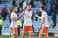 Blackpool Players Celebrate at full time Blackpool Defender, Clark Robertson (5) Blackpool Midfielder, Jay Spearing (44) Blackpool Forward, Danny Philliskirk (18) during the EFL Sky Bet League 1 match between Portsmouth and Blackpool at Fratton Park, Portsmouth, England on 24 February 2018. Picture by Adam Rivers.