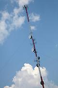 Communication tower with saucer like transmitters. Alexandria Minnesota MN USA