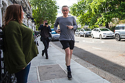 © Licensed to London News Pictures. 28/05/2019. London, UK. Secretary of State for Environment, Food and Rural Affairs Michael Gove, who is running to be the next leader of the Conservative Party and Prime Minister, returns after a run. Photo credit: Rob Pinney/LNP