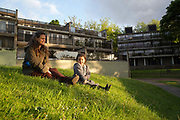 A mother with her young daughter at Central Hill Estate on 24th May 2016 in South London, United Kingdom. Central Hill is a low-rise estate of more than 450 homes in Crystal Palace in South London and has been recommended for demolition under Lambeth Council estate regeneration plan. The housing scheme, built between 1966 and1974, was designed by Rosemary Stjernstedt under Lambeth Council's director of architecture, Ted Hollamby.