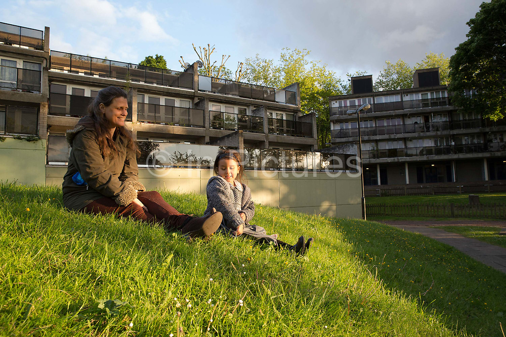 A mother with her young daughter at Central Hill Estate on 24th May 2016 in South London, United Kingdom. Central Hill is a low-rise estate of more than 450 homes in Crystal Palace in South London and has been recommended for demolition under Lambeth Council estate regeneration plan. The housing scheme, builtbetween 1966 and1974, was designed by Rosemary Stjernstedt under Lambeth Council's director of architecture,Ted Hollamby.
