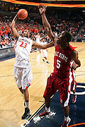 CHARLOTTESVILLE, VA- NOVEMBER 13: Mike Scott #23 of the Virginia Cavaliers shoots next to Omar Sanders during the game on November 13, 2011 at the John Paul Jones Arena in Charlottesville, Virginia. Virginia defeated South Carolina State 75-38. (Photo by Andrew Shurtleff/Getty Images) *** Local Caption *** Mike Scott;Omar Sanders