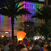 Member of the crowd release floating lanters into the sky during a vigil at the Dr. Phillips Center for the Performing Arts for the victims of a mass shooting at the Pulse nightclub Monday, June 13, 2016, in Orlando, Florida.  A gunman killed dozens of people in a massacre at the crowded gay nightclub in Orlando on Sunday, making it the deadliest mass shooting in modern U.S. history. (Alex Menendez via AP)