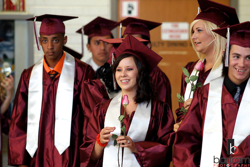 Live Oak High School seniors line up as they await the start of graduation at the Beede Auditorium at Antioch High School on Thursday, June 7, 2012. (Photo by Kevin Bartram)