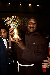 Kenyan Peter Tabichi, teacher at Keriko Secondary School in Nakuru, Kenya poses with his « Global Teacher Prize 2019 » in Dubai, United Arab Emirates, on March 24, 2019. The Global Teacher Prize serves to underline the importance of educators and the fact that, throughout the world, their efforts deserve to be recognised and celebrated. The US $1 million award from the Varkey Foundation is presented annually to an exceptional teacher who has made an outstanding contribution to their profession. Photo by GESF-Balkis Press/ABACAPRESS.COM
