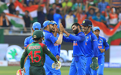 September 21, 2018 - Dubai, United Arab Emirates - Indian cricketers celebrate after taking a wicket  during the 1st cricket match of the Super four group  of Asia Cup 2018 between India and Bangaldesh at Dubai International cricket stadium,Dubai, United Arab Emirates on 21 September 2018. (Credit Image: © Tharaka Basnayaka/NurPhoto/ZUMA Press)