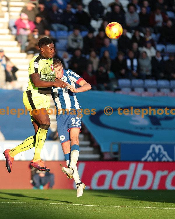 Reading defender Tyler Blackett (24) heads clear during the Sky Bet Championship match between Wigan Athletic and Reading at the DW Stadium in Wigan. November 5, 2016.<br /> Nigel Pitts-Drake / Telephoto Images<br /> +44 7967 642437