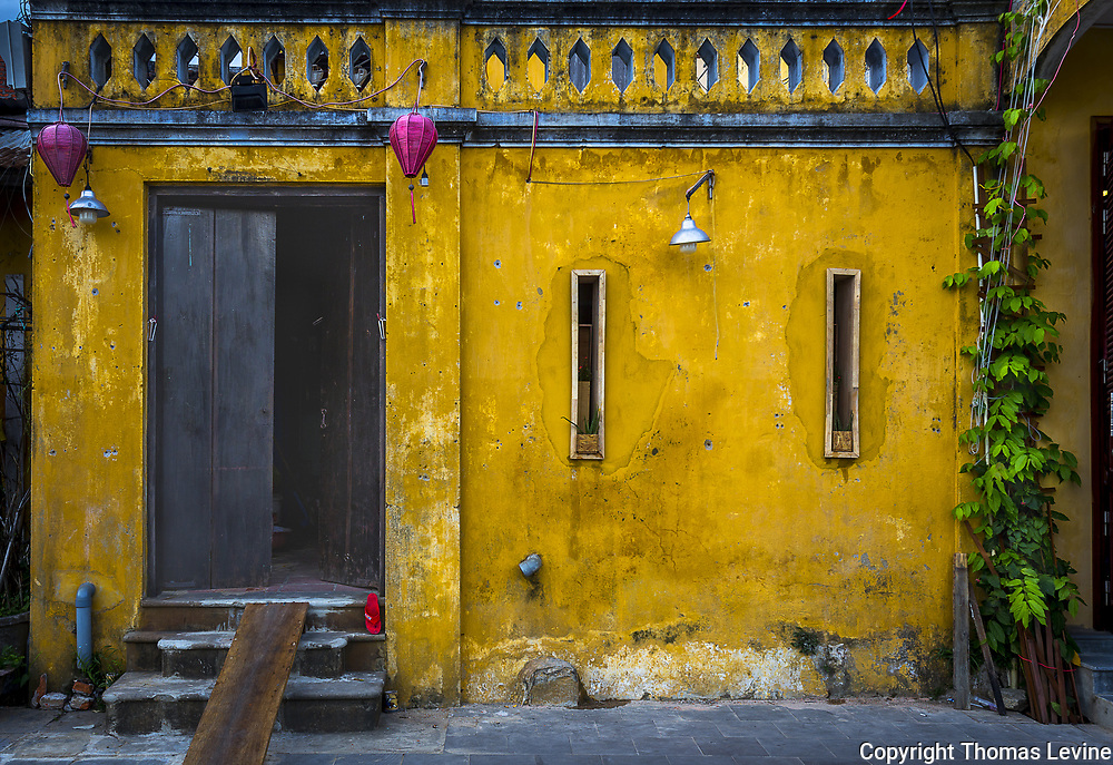 Front of an old yellow house in Ancient Town, Hoi An.