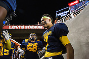 Milpitas High School running back Dejaun Crummie, 7, sparks up his teammates before taking on Valley Christian High School during Friday Night Lights at Levi's Stadium in Santa Clara, California, on September 18, 2015.  Milpitas went on to lose 22-21 against Valley Christian.  (Stan Olszewski/SOSKIphoto)