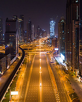Aerial view of empty streets at night due to the coronavirus pandemic in Dubai, United Arab Emirates