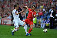 Gareth Bale of Wales is challenged by Israel's Orel Dgani. Euro 2016 qualifying match, Wales v Israel at the Cardiff city stadium in Cardiff, South Wales on Sunday 6th Sept 2015.  pic by Andrew Orchard, Andrew Orchard sports photography.