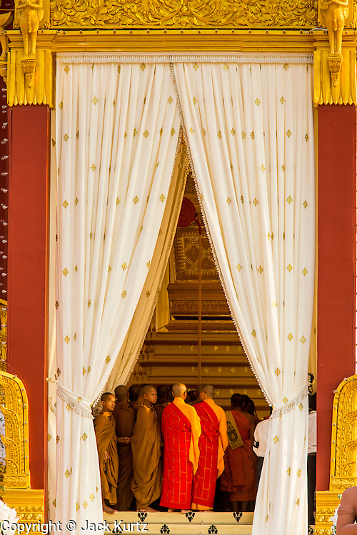 """03 FEBRUARY 2013 - PHNOM PENH, CAMBODIA:  Buddhist monks at the final Buddhist chanting service for former Cambodian King Norodom Sihanouk in the crematorium built for the King's funeral at the National Museum in Phnom Penh. Norodom Sihanouk (31 October 1922- 15 October 2012) was the King of Cambodia from 1941 to 1955 and again from 1993 to 2004. He was the effective ruler of Cambodia from 1953 to 1970. After his second abdication in 2004, he was given the honorific of """"The King-Father of Cambodia."""" He served as puppet head of state for the Khmer Rouge government in 1975-1976, before going into exile. Sihanouk's actual period of effective rule over Cambodia was from 9 November 1953, when Cambodia gained its independence from France, until 18 March 1970, when General Lon Nol and the National Assembly deposed him. Upon his final abdication in 2004, the Cambodian throne council appointed Norodom Sihamoni, one of Sihanouk's sons, as the new king. Sihanouk died in Beijing, China, where he was receiving medical care, on Oct. 15, 2012. His cremation will take place on Feb. 4, 2013. Over a million people are expected to attend the service.    PHOTO BY JACK KURTZ"""