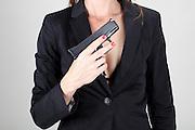 Woman holds handgun Model released