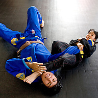 032913      Adron Gardner<br /> <br /> Amy Mitchell, right, demonstrates an arm bar on Bronson MItchell at Nayee'eji Fierce MMA/Jiu-Jitsu in Gallup Friday.