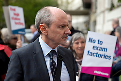 @ Licensed to London News Pictures. Rod Bristow, President of UK and Global Online Learning for Pearson Education speaking to protesters outside the companies Head Quarters in London on April 29, 2016. On August 19, 2020 it was announced nearly half a million UK pupils face a fresh round of results chaos after exam board Pearson pulled its BTec results on the eve of releasing them. Photo credit: LNP