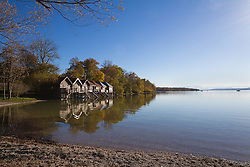 Lake shore boathouse sunset autumn trees horizon