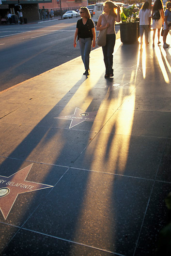 Tourists walk on Hollywood Boulevard star walk of fame in Hollywood Los Angeles California, USA