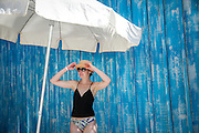 SHOT 2/1/16 11:52:49 AM - Meredith Hogan of Denver, Co. poses for a portrait at a beachside cafe in Punta Mita, Mexico. Punta Mita is a 1,500-acre (6.1 km2) beachfront village located on the north end of Banderas Bay in the Mexican state of Nayarit, about 10 miles (16 km) north of Puerto Vallarta, Jalisco. Punta Mita is surrounded on three sides by nine and a half miles of Pacific Ocean beaches and coves including Litibu Bay. Because of its temperate, tropical climate, Punta Mita is a popular but low-key vacation spot. (Photo by Marc Piscotty / © 2016)