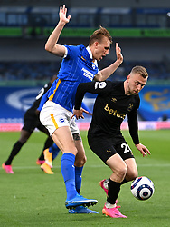 Brighton and Hove Albion's Dan Burn (left) and West Ham United's Jarrod Bowen during the Premier League match at the American Express Community Stadium, Brighton. Picture date: Saturday May 15, 2021.