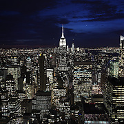 A panoramic view of Manhattan, New York, at night time from the Top of the Rock, the observatory deck at Rockefeller Center showing the Empire State Building, Manhattan, New York, USA.  Photo Tim Clayton