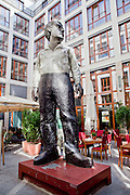 Germany, Berlin Statue of a boy ion a courtyard