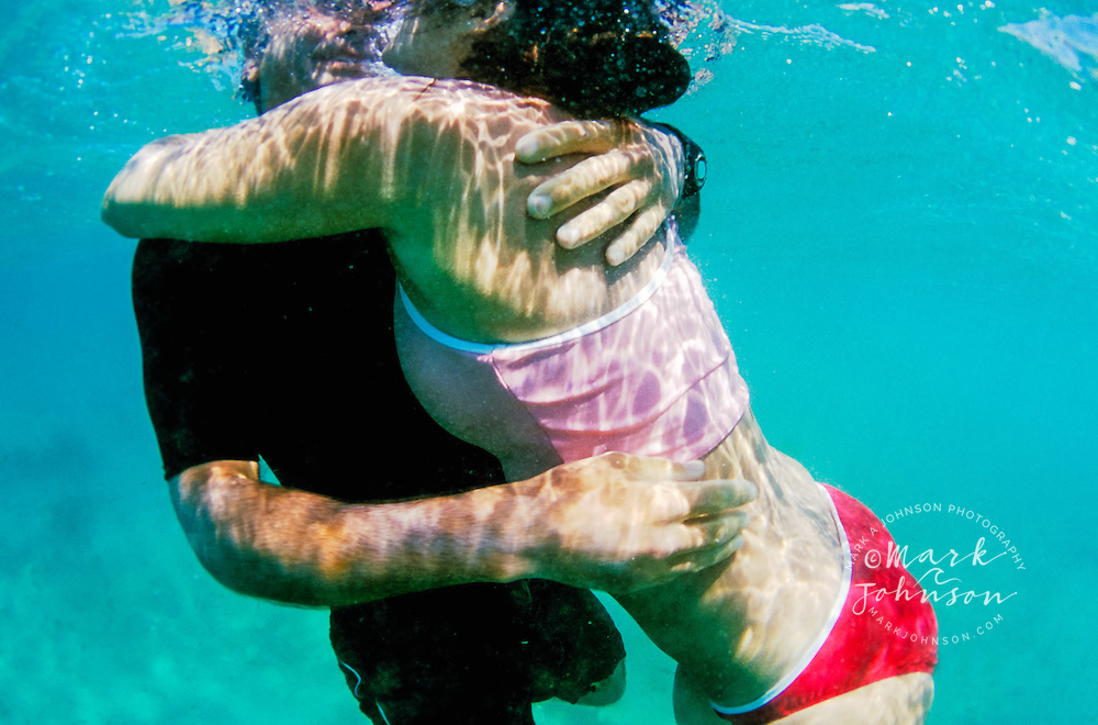 Australia --- Couple Embracing Underwater people ****Model Release available