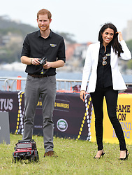 Prince Harry Duke of Sussex and Meghan Duchess of Sussex attend the Invictus Games Land Rover Challenge on Cockatoo Island, Sydney. Photo credit should read: Doug Peters/EMPICS