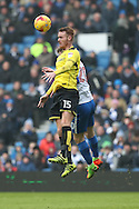 Burton Albion midfielder Tom Naylor (15) wins a header during the EFL Sky Bet Championship match between Brighton and Hove Albion and Burton Albion at the American Express Community Stadium, Brighton and Hove, England on 11 February 2017.