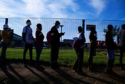 May 5, 2020 - Johannesburg, Gauteng, South Africa - Thousands come from the townships of Alexandra as they need to stand in a queue for the limited numbers of people allowed in the mall.  (Credit Image: © Manash Das/ZUMA Wire/ZUMAPRESS.com)